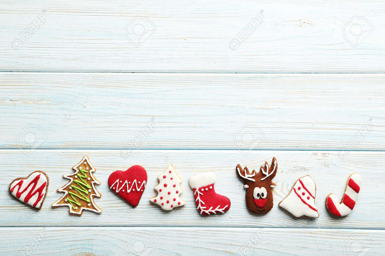 Christmas cookies on a blue wooden table - 48772549
