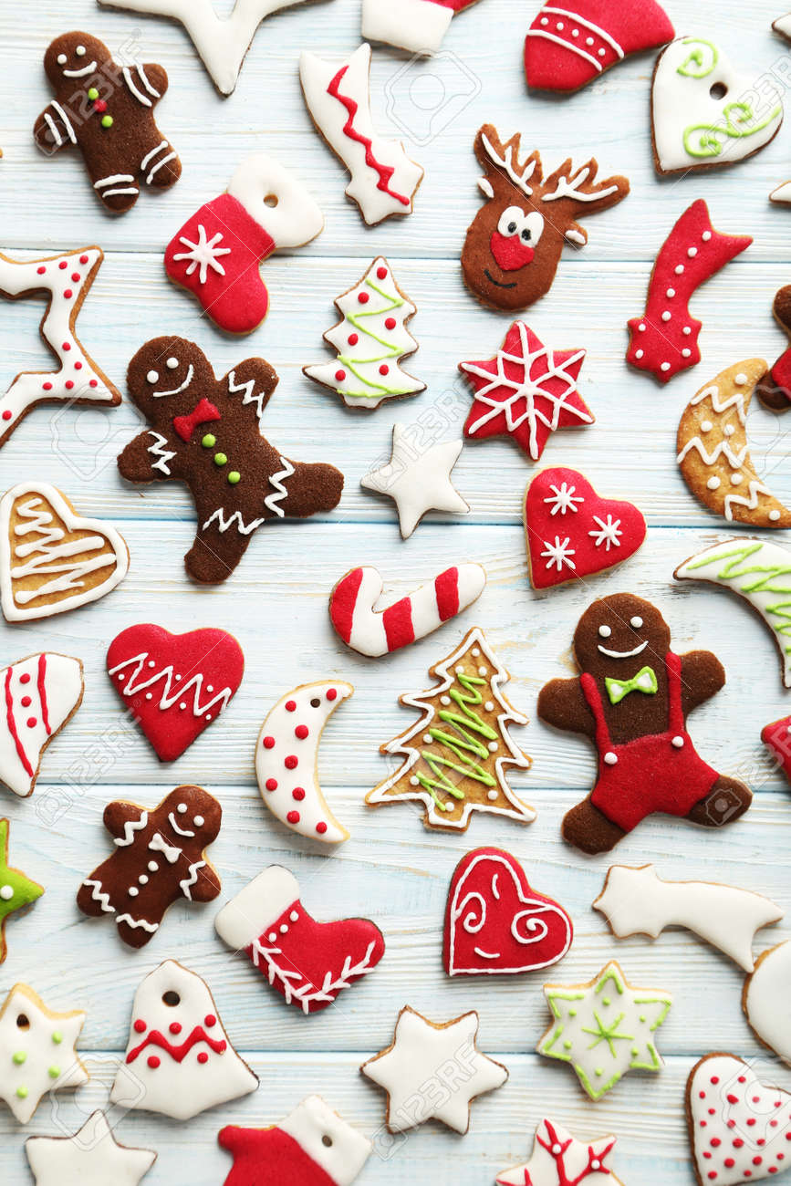 Christmas cookies on a blue wooden table - 48772559