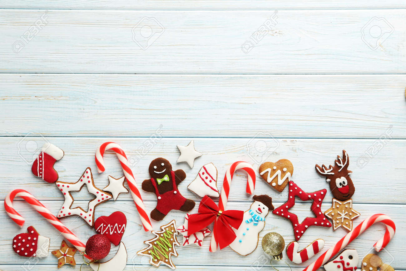 Christmas cookies on a blue wooden table - 48928686