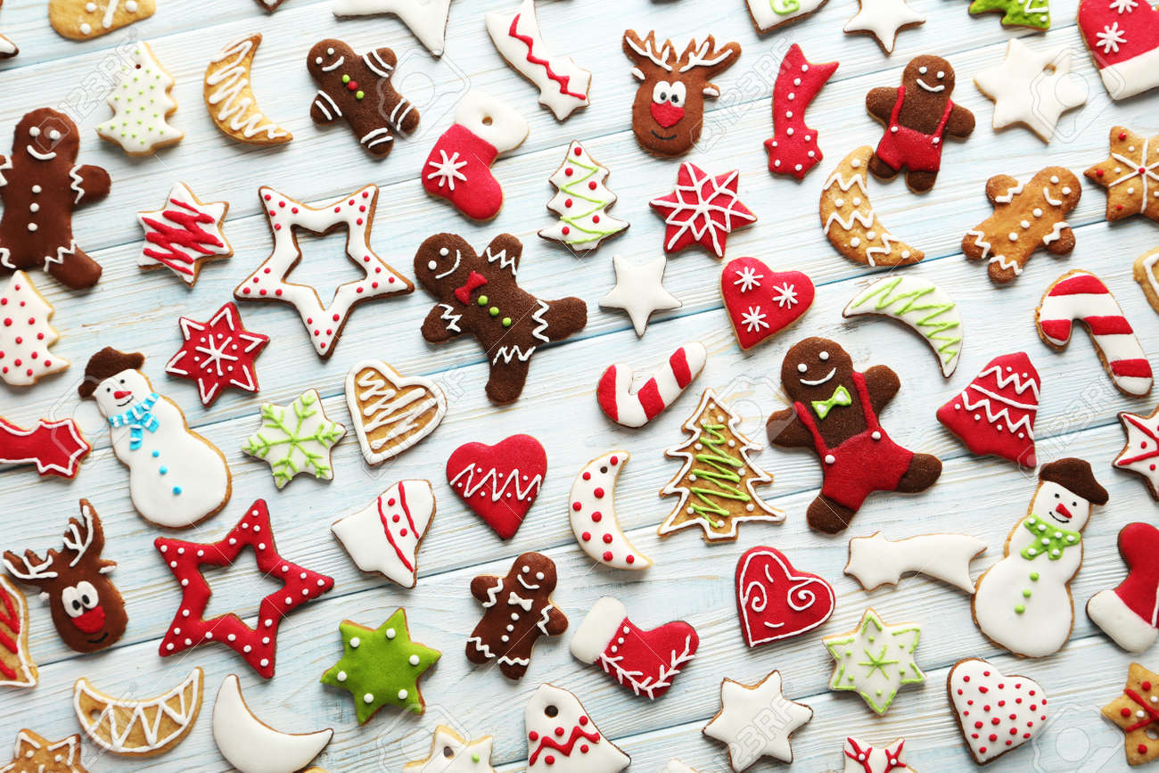 Christmas cookies on a blue wooden table - 48928999
