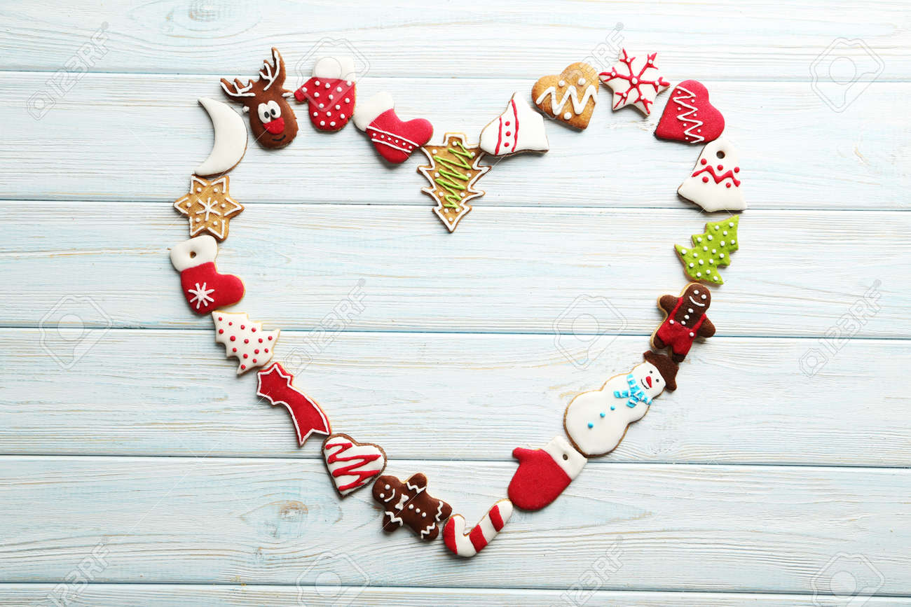 Christmas cookies on a blue wooden table - 48929318