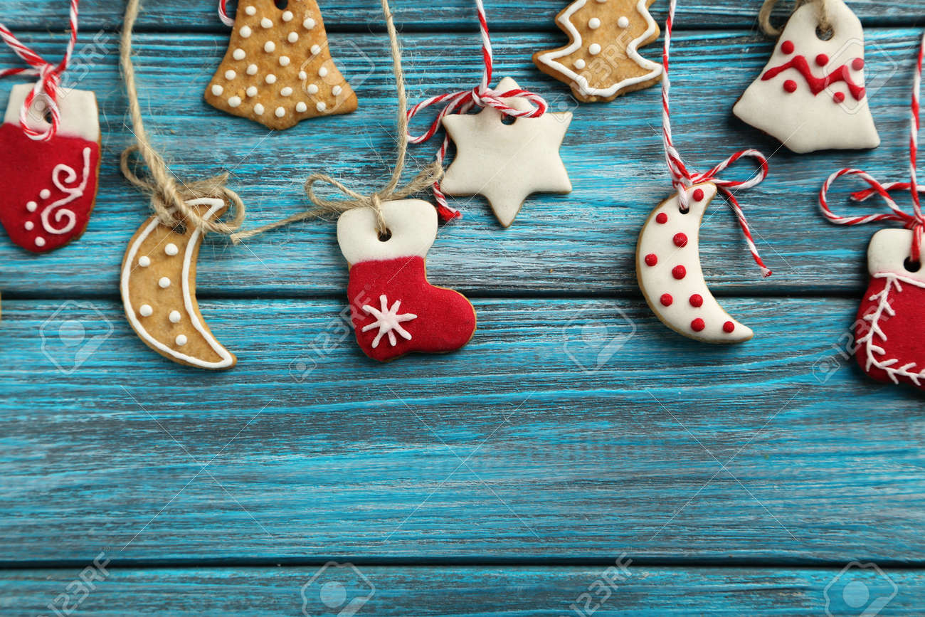Christmas cookies on a blue wooden table - 49304134