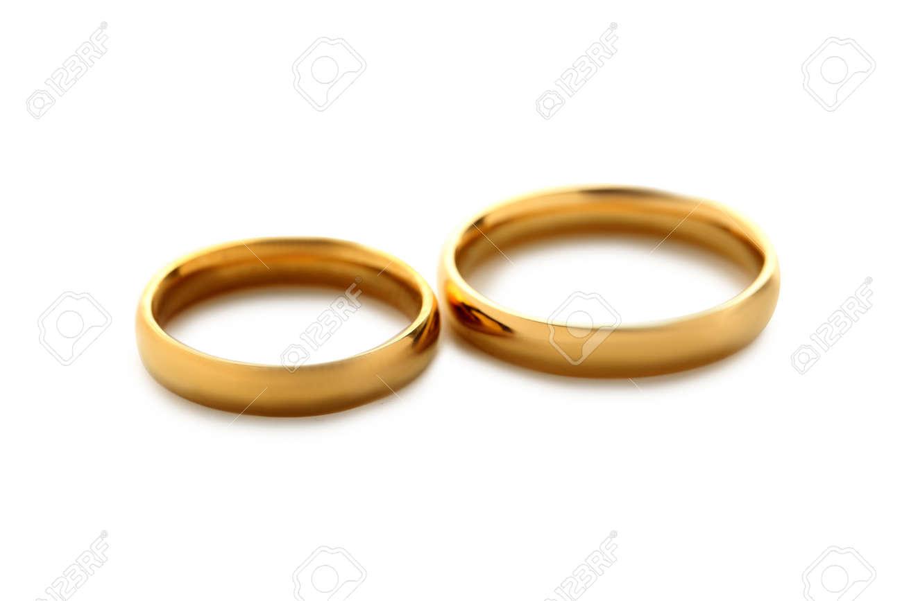 Goldene Hochzeit Ringe Auf Einem Weissen Isoliert Lizenzfreie Fotos
