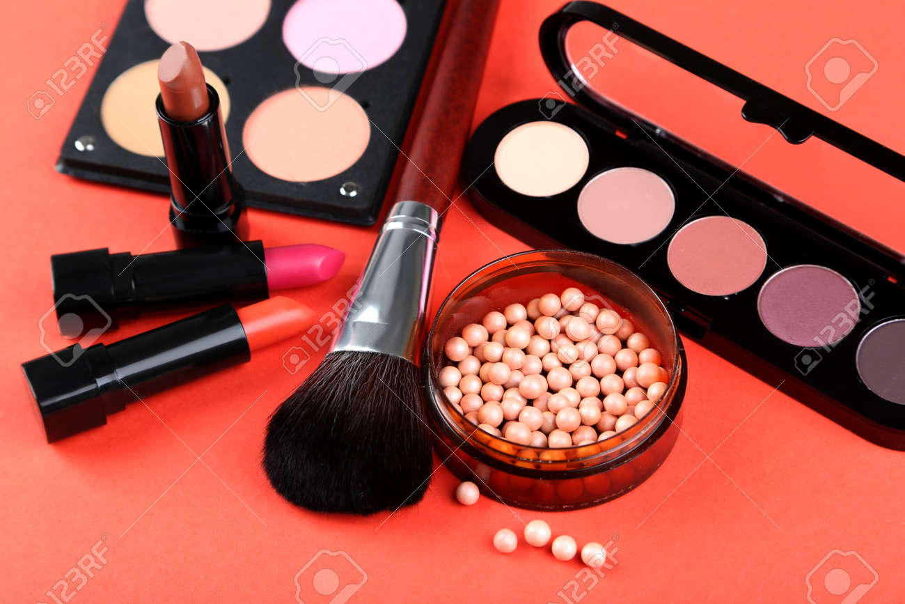 Makeup brush and cosmetics on a red background - 50516060
