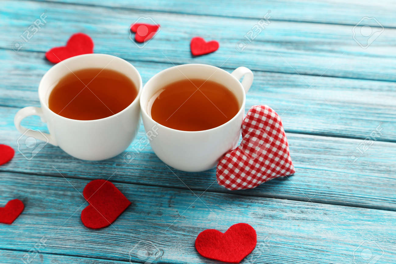 Love hearts with cups of tea on a blue wooden table - 50736125