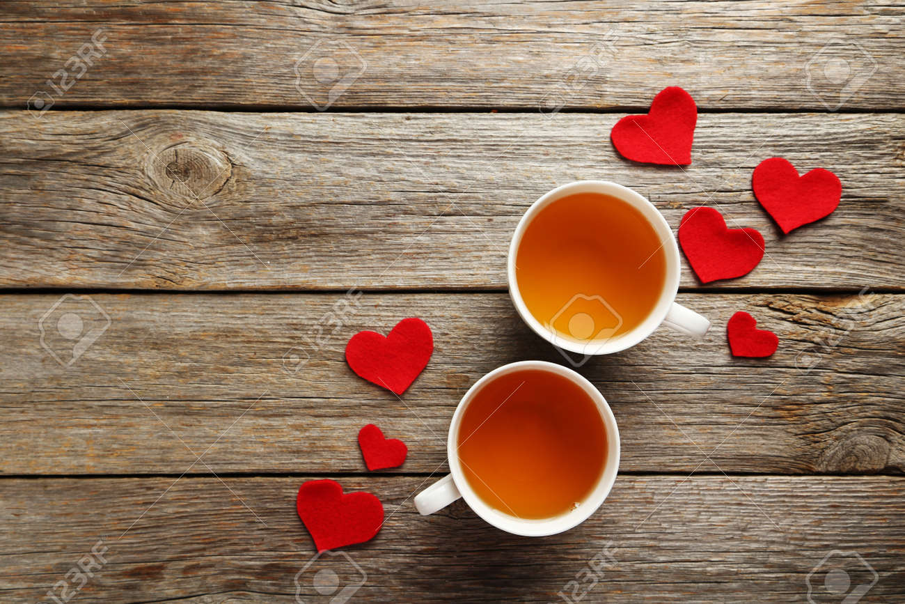 Love hearts with cups of tea on a grey wooden table - 50736659
