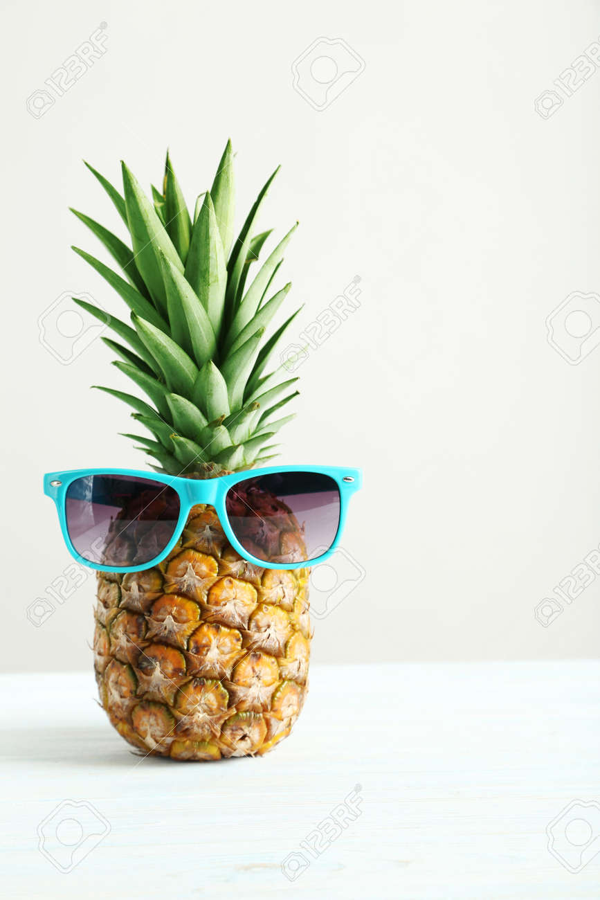 Ripe pineapple on a white wooden table - 51102033