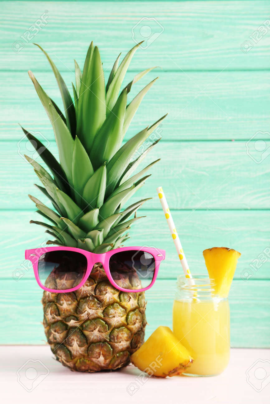 Bottle of pineapple juice on a pink wooden table - 51480231