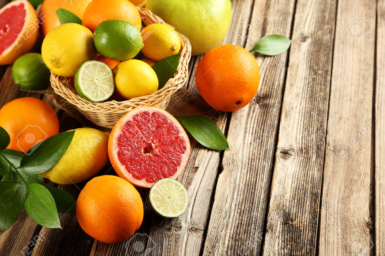 Citrus fruits on a brown wooden table - 51481350