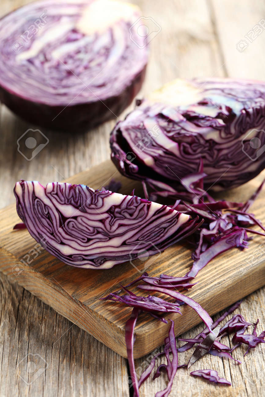 Ripe red cabbage on a grey wooden table - 52312886