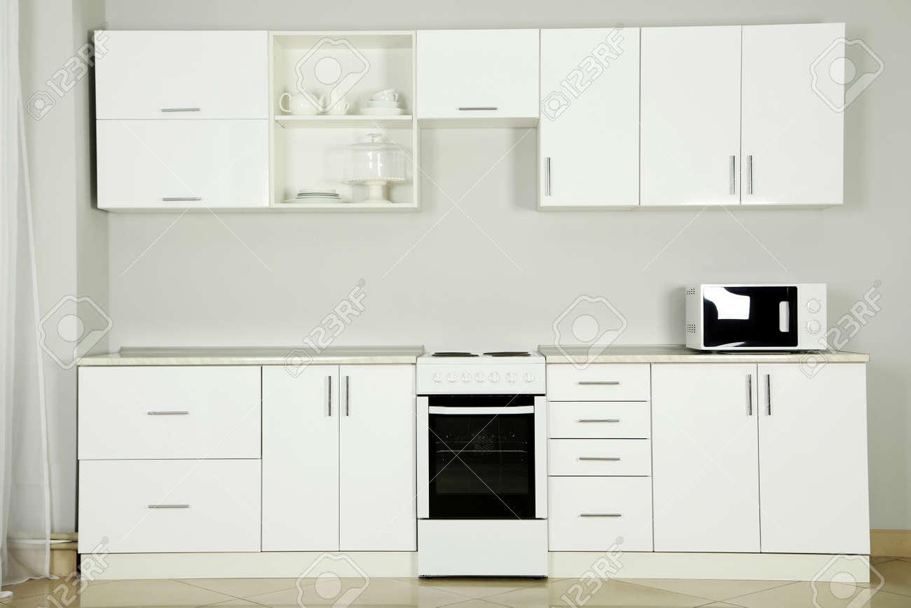 The new white kitchen interior, close up - 54613634