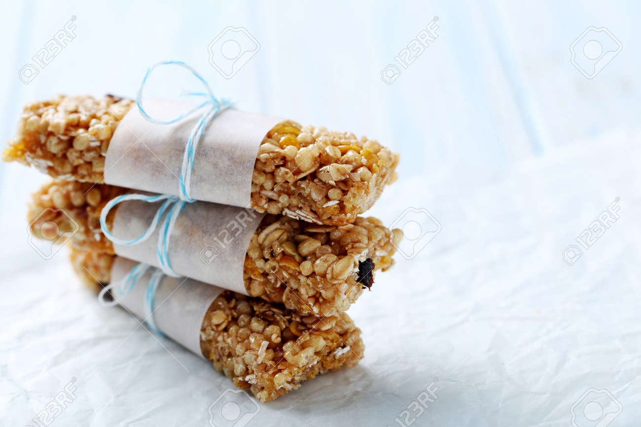 Granola bar on a blue wooden table - 56545610