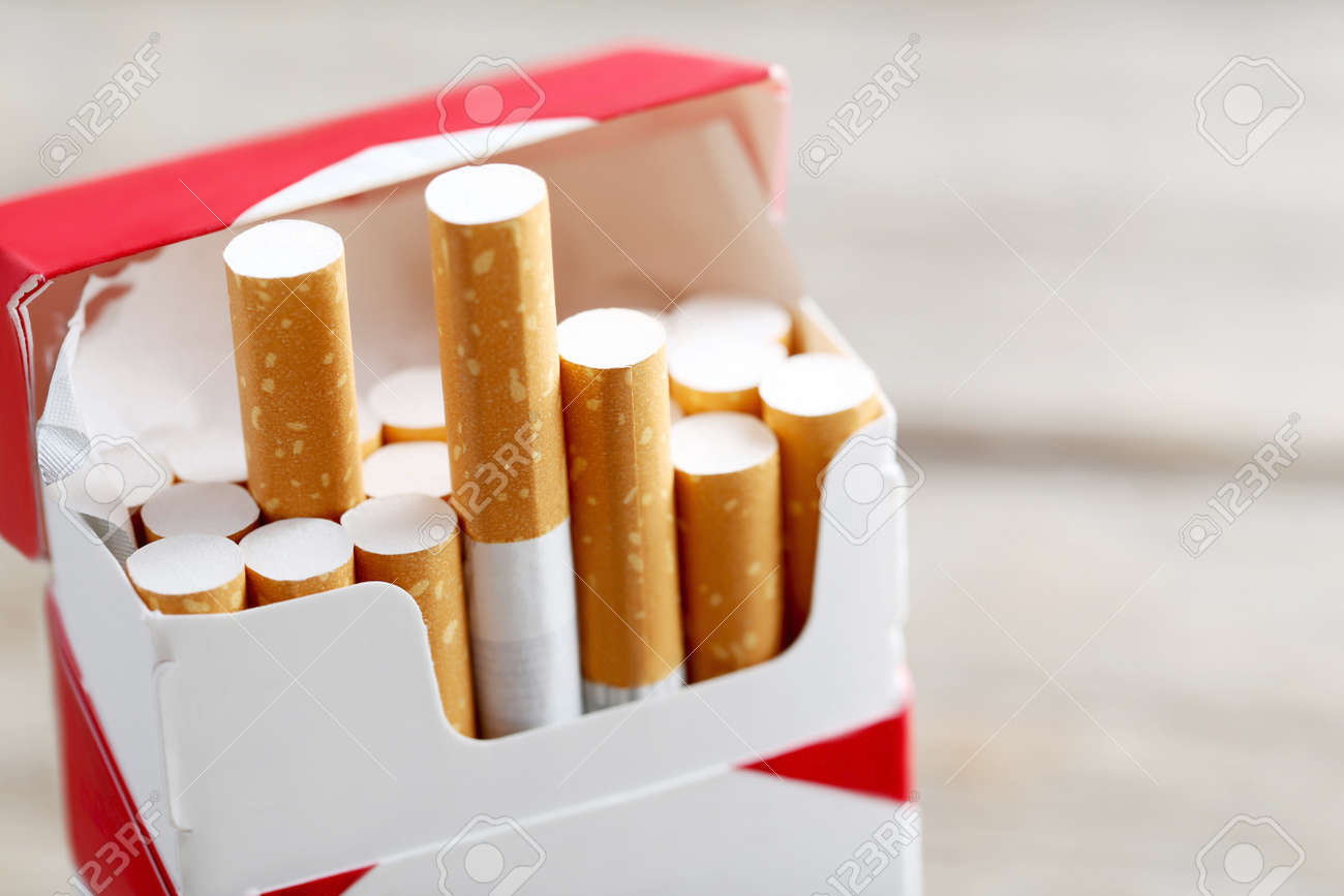 Open pack of cigarettes - 64613580