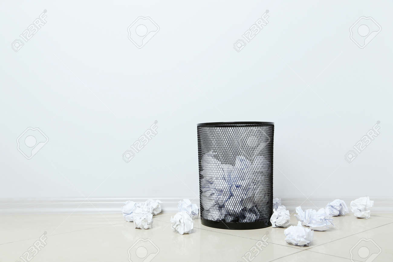 Office Trashcan With Crumpled Paper Balls On Grey Background Stock Photo    68074477