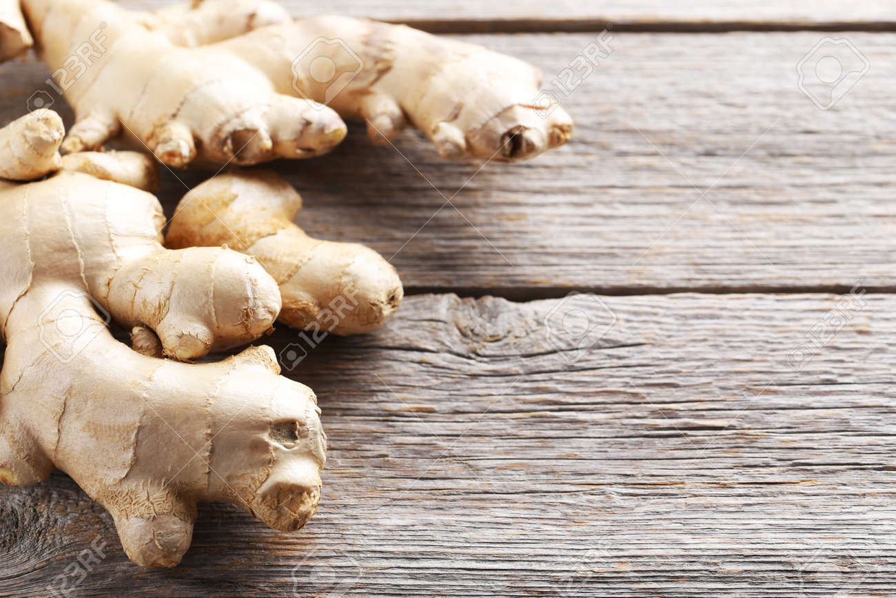 Ginger root on grey wooden table - 69026691