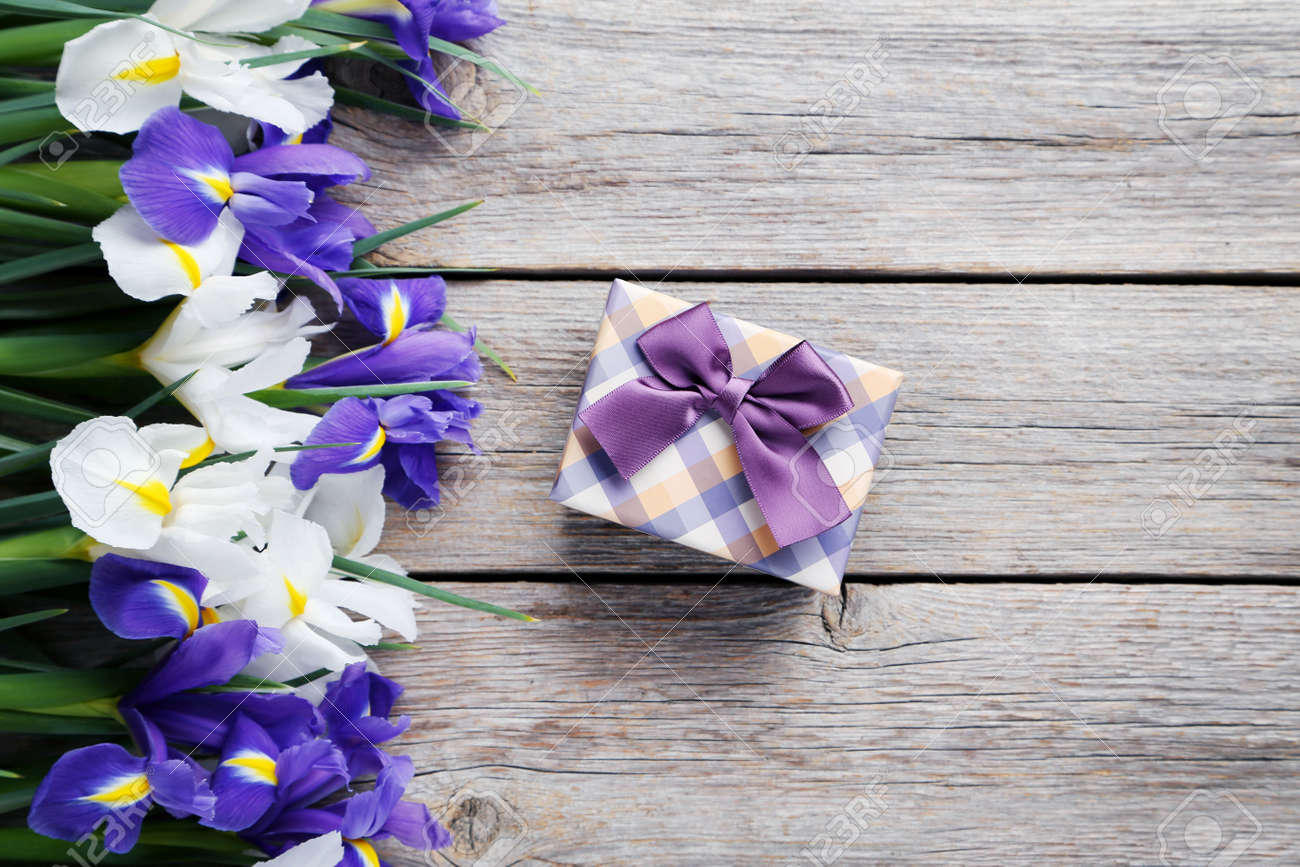 Bouquet of iris flowers on grey wooden table stock photo picture bouquet of iris flowers on grey wooden table stock photo 75334318 izmirmasajfo Image collections