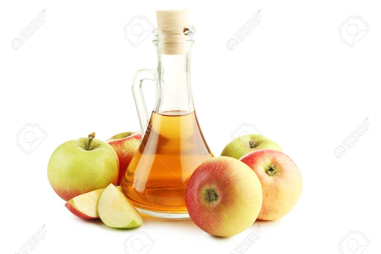 Apple vinegar in glass bottle isolated on white - 93594617