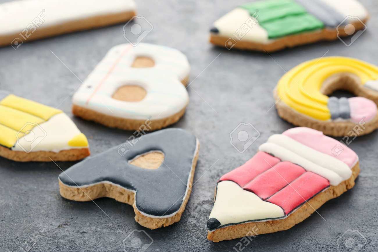 Gingerbread cookies on grey wooden table - 87866621