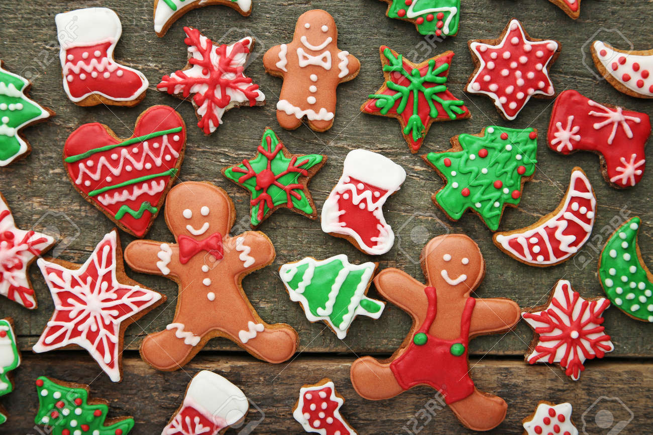 Christmas Gingerbread Cookies On Grey Wooden Table