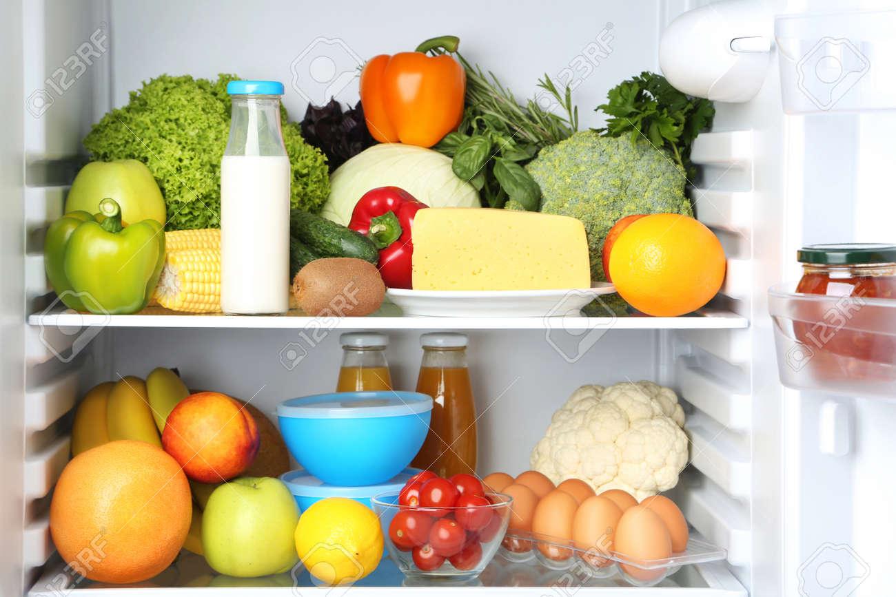 Open fridge full of vegetables and fruits - 91614107