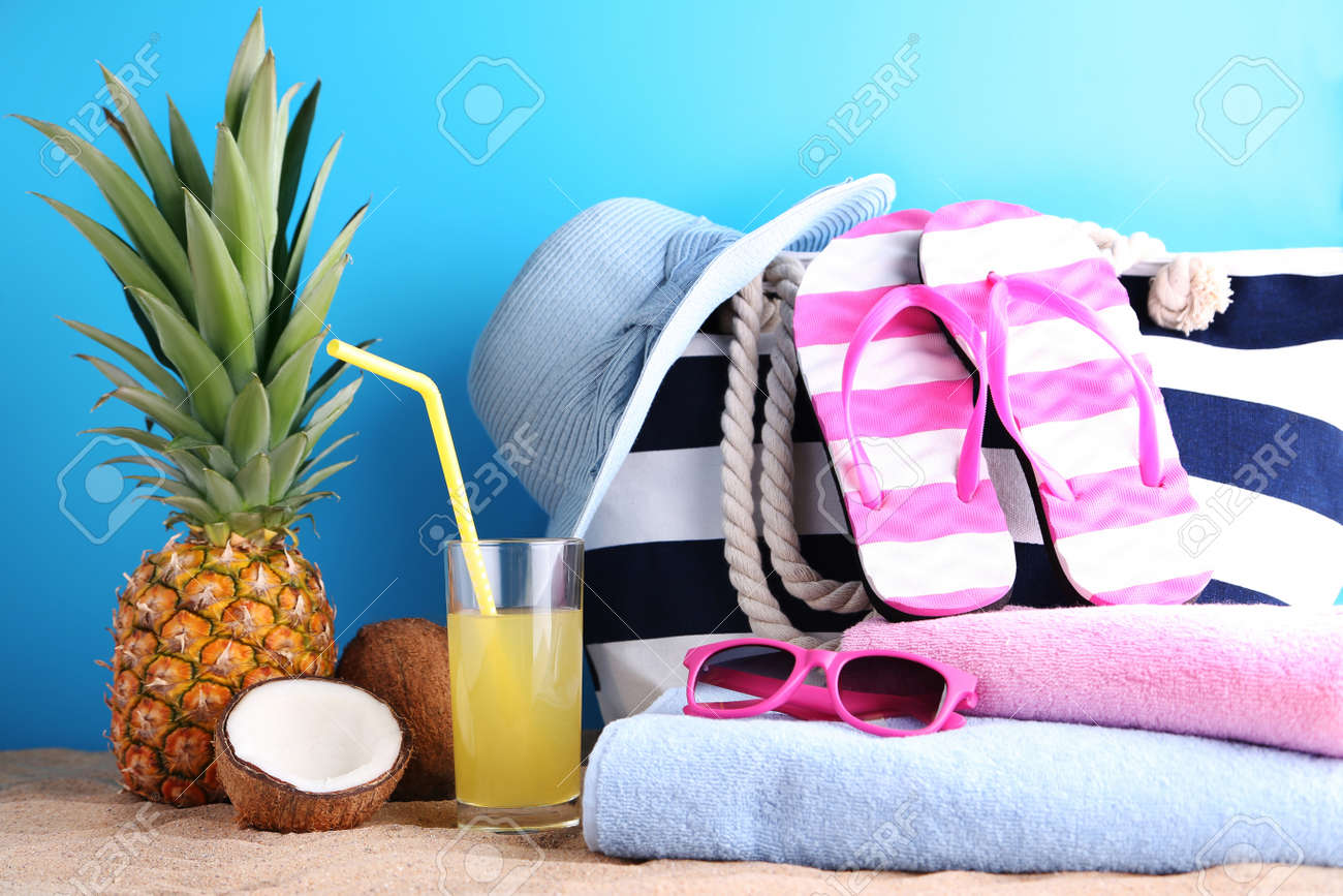 e86d58726c4 Pineapple juice with coconut and beach accessories Stock Photo - 95404603