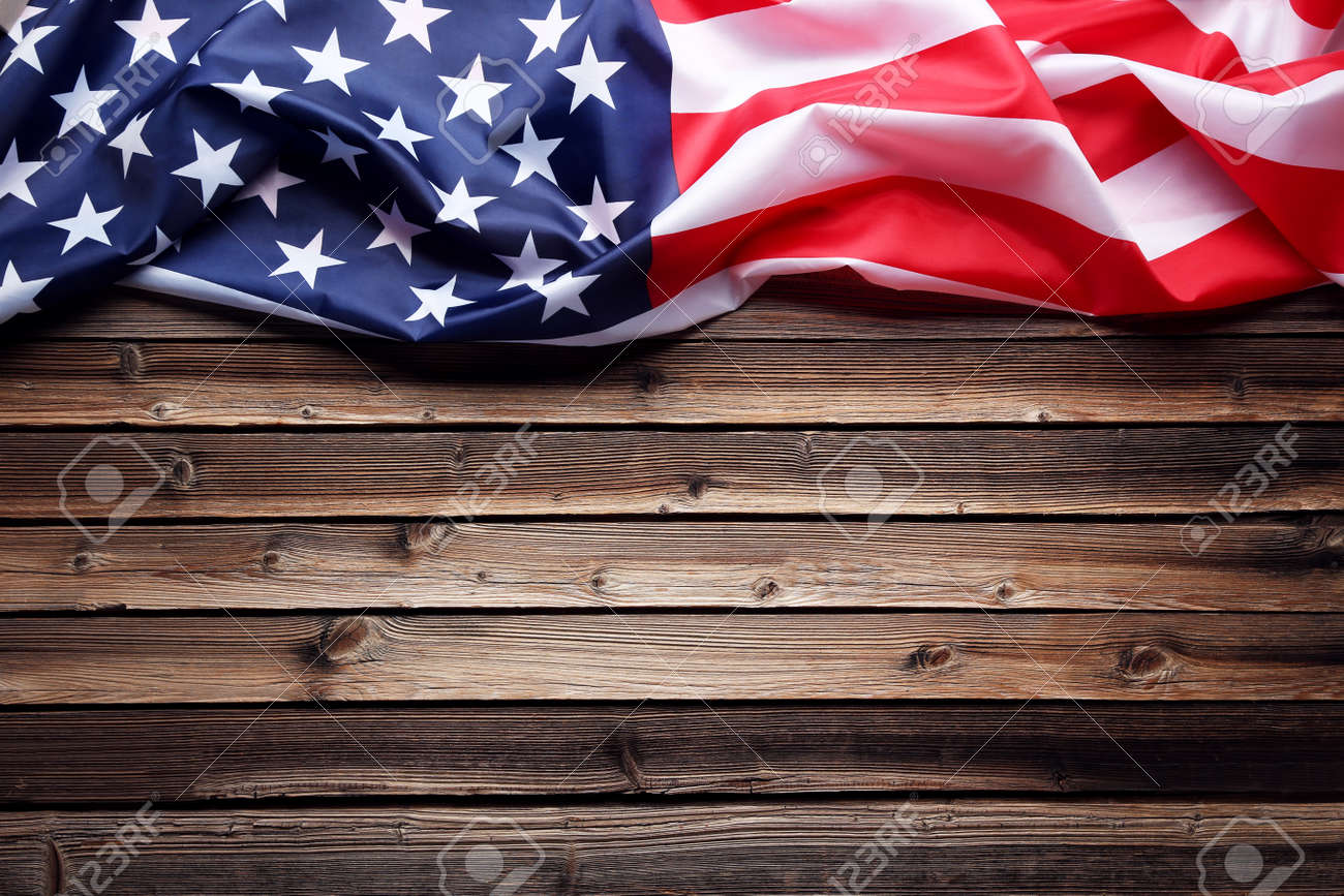 American Flag On Brown Wooden Table Stock Photo