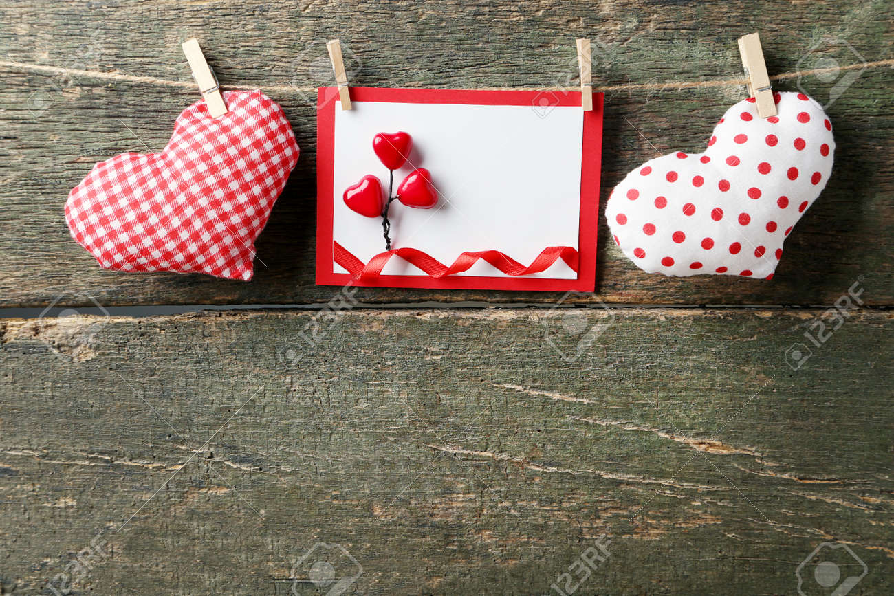 Greeting Card With Fabric Hearts On Grey Wooden Background Stock Photo Picture And Royalty Free Image Image 96772143