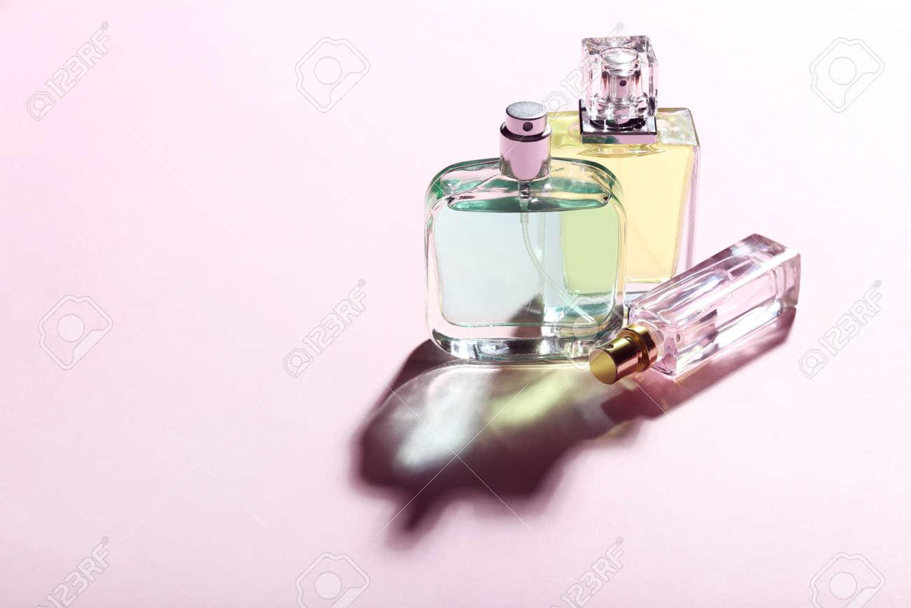 Perfume bottles on pink background - 97393038