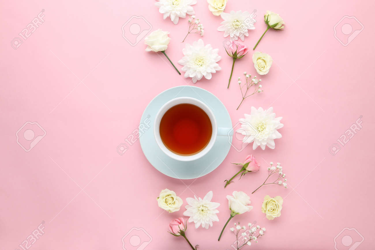 Flowers with cup of tea on pink background - 105954993