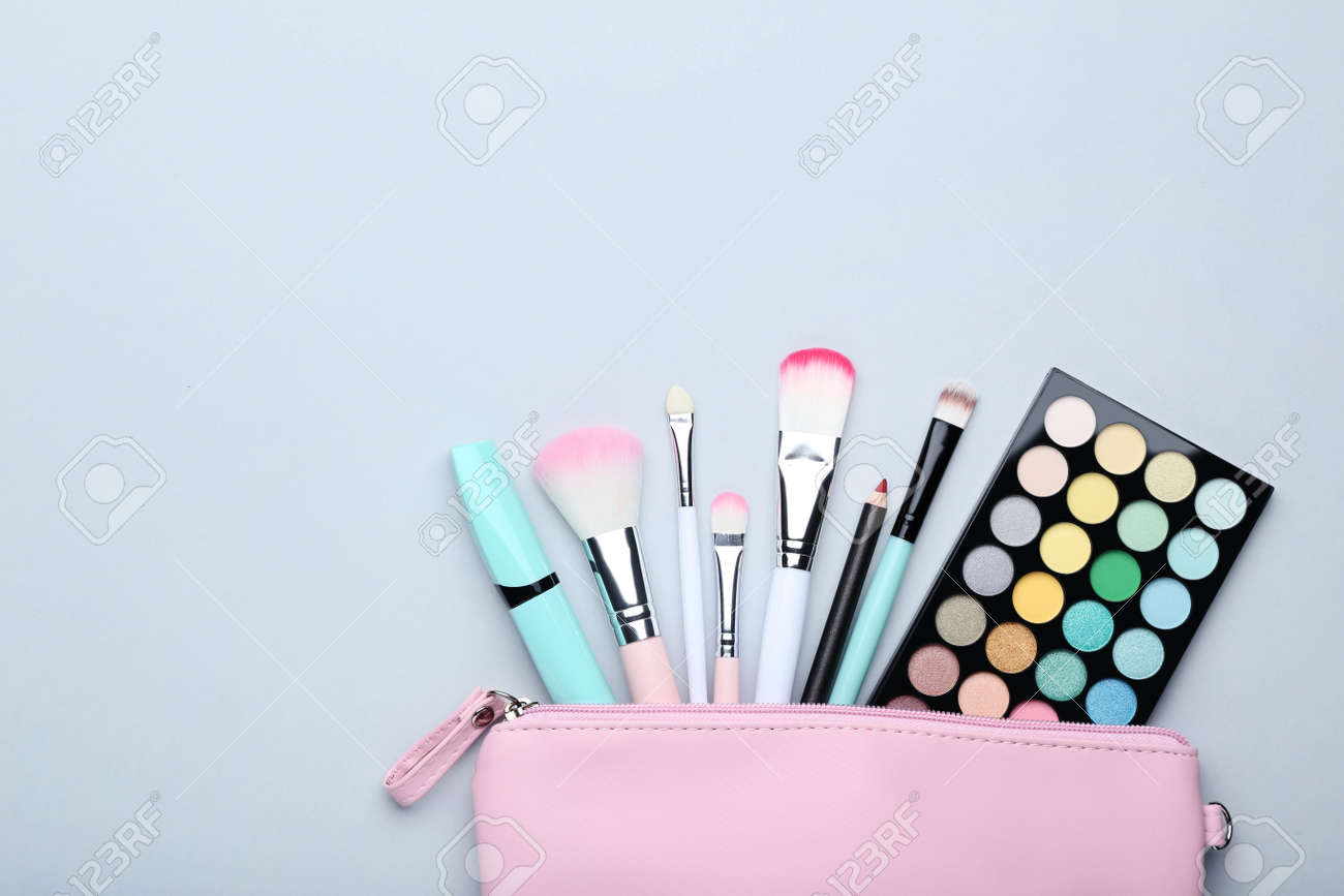 Different makeup cosmetics on grey background - 112578710