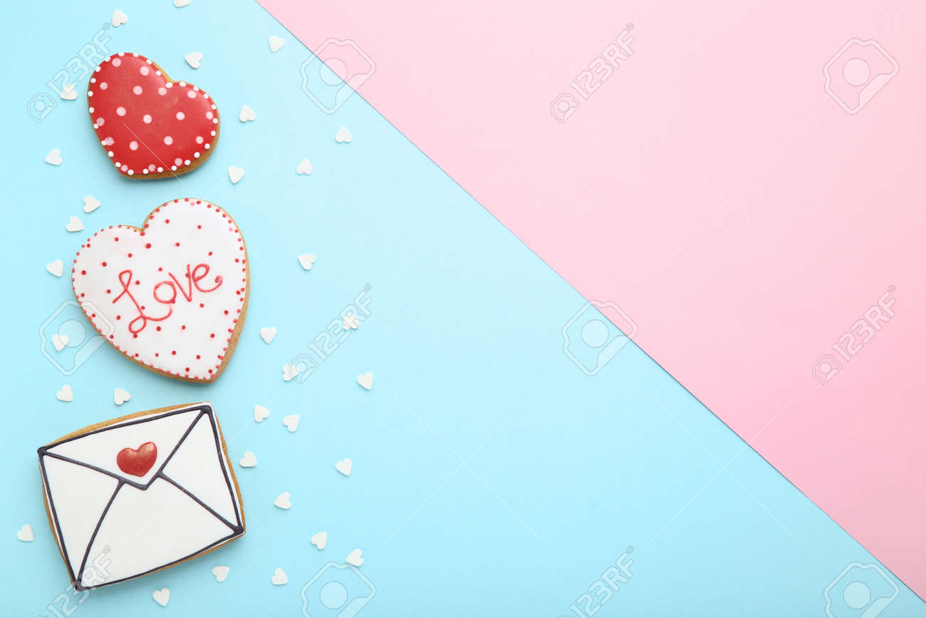 Valentine day cookies with sprinkles on colorful background - 120768141