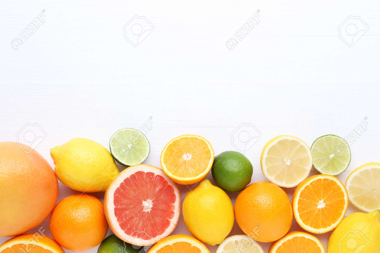 Citrus fruits on white wooden table - 128885049