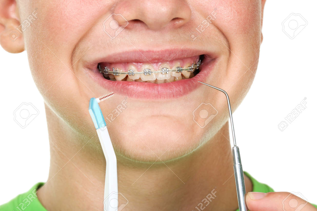 Young man with toothbrush and dentist tool on white background - 138225110