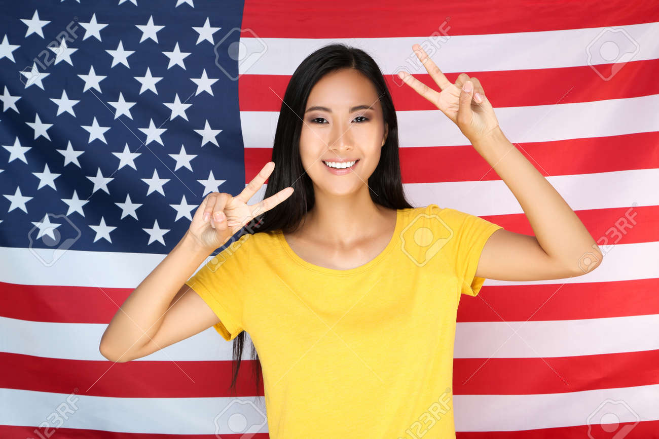 Young woman on American flag background - 149867577