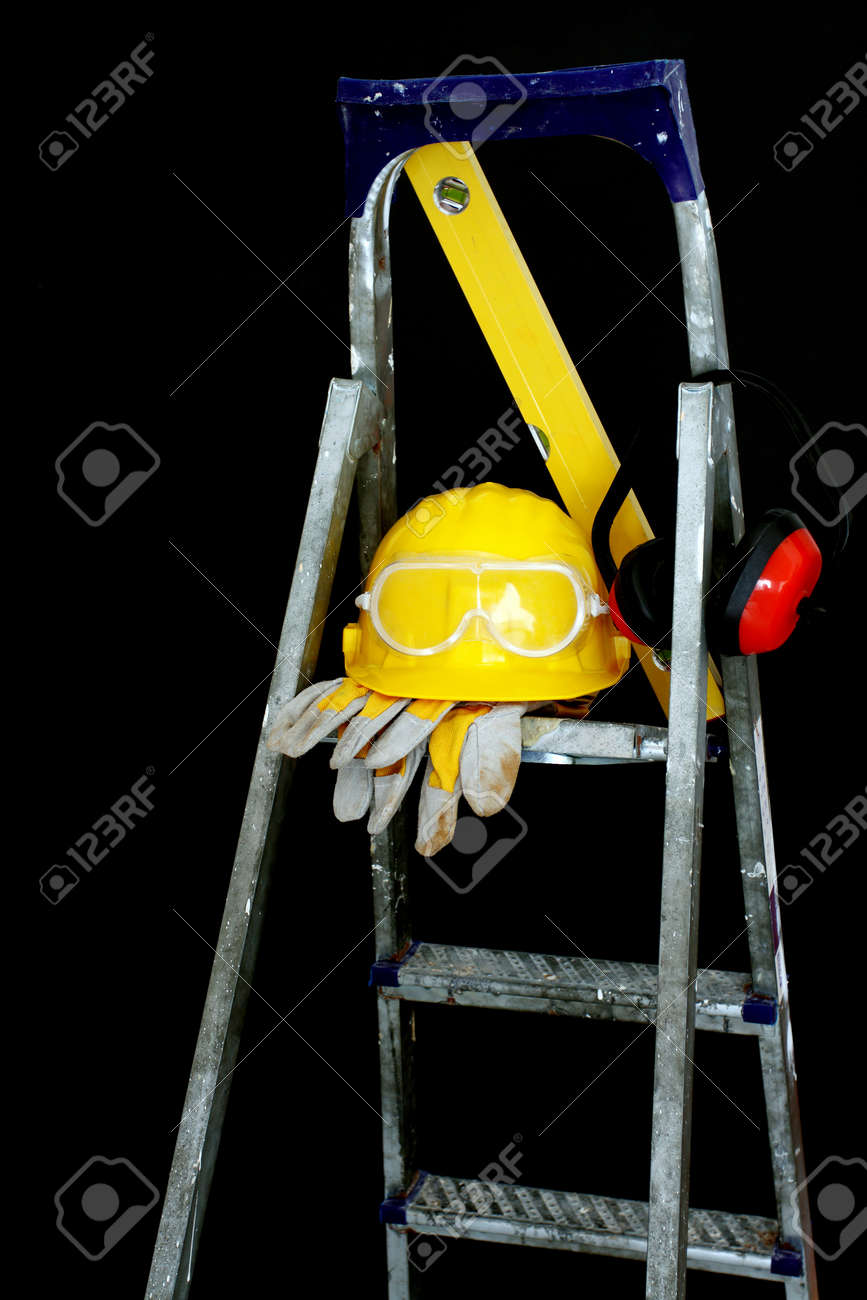 Safety gear kit on step ladder over black Stock Photo - 9529062