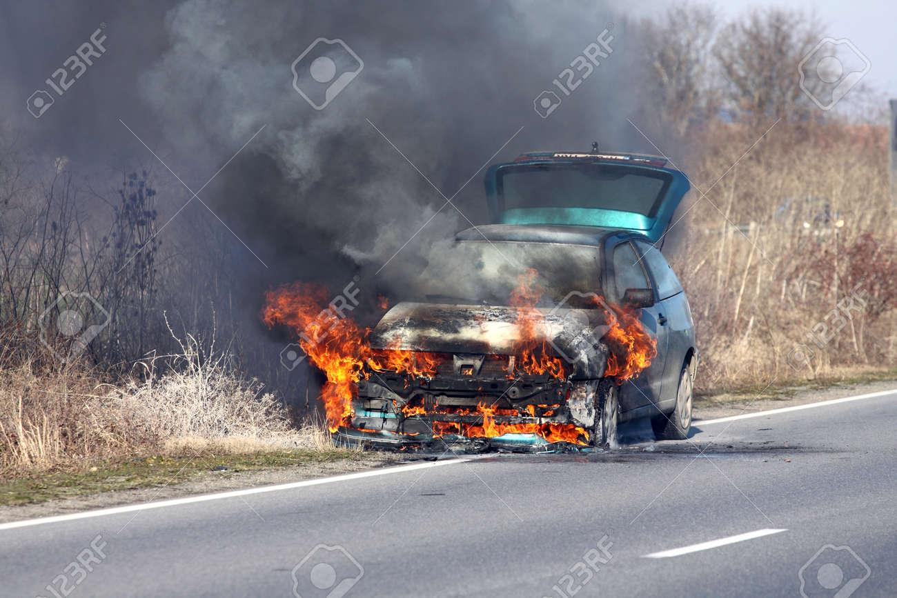 burning car on the road Stock Photo - 11971283