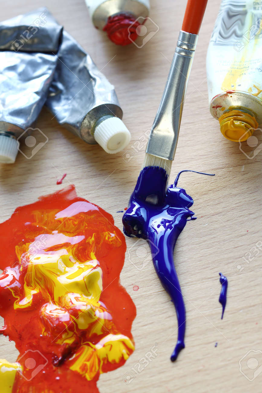Close up of colorful paint, tubes and brush. Focus in the brush Stock Photo - 13667608