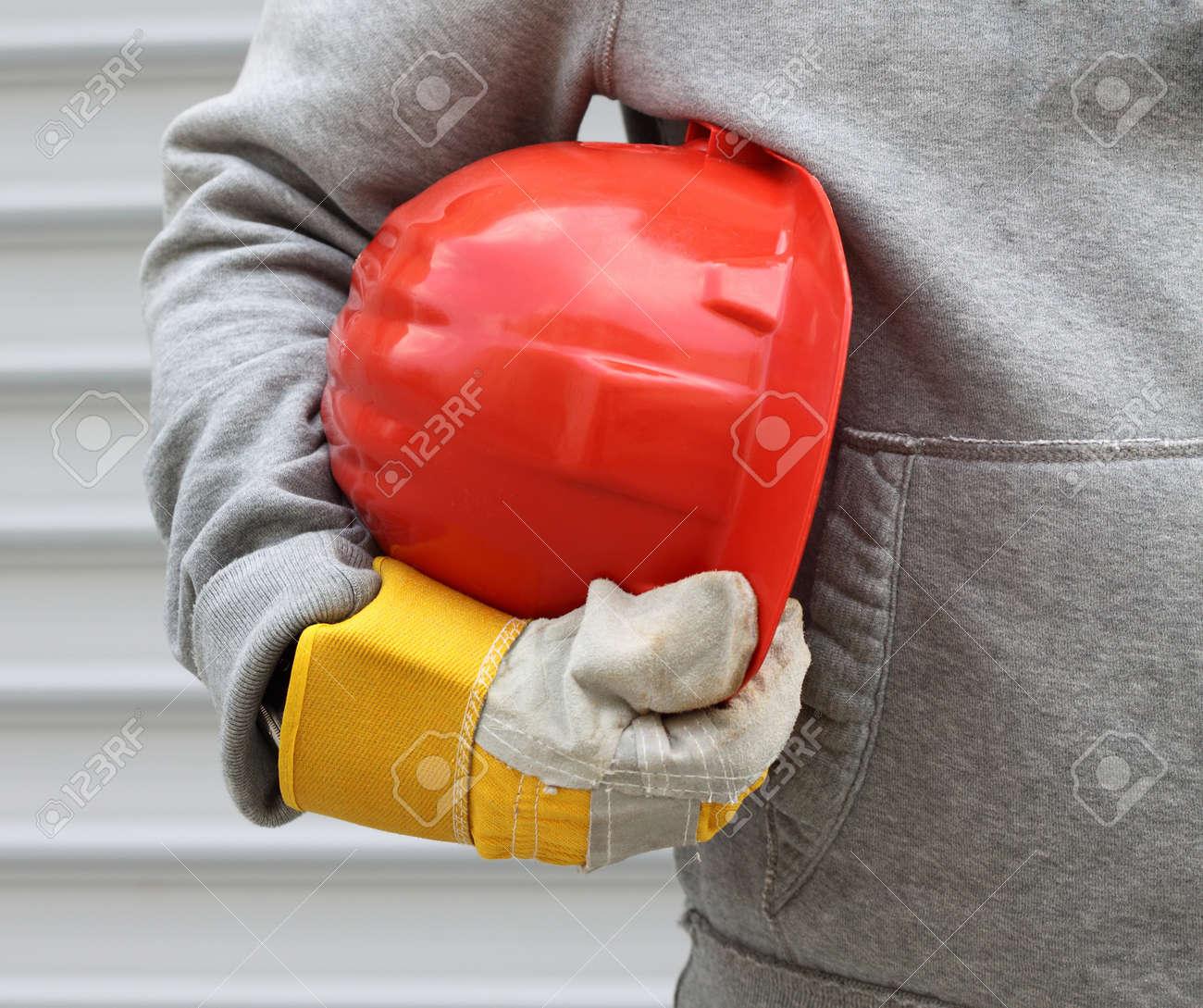 Man holding red helmet close up Stock Photo - 13711459