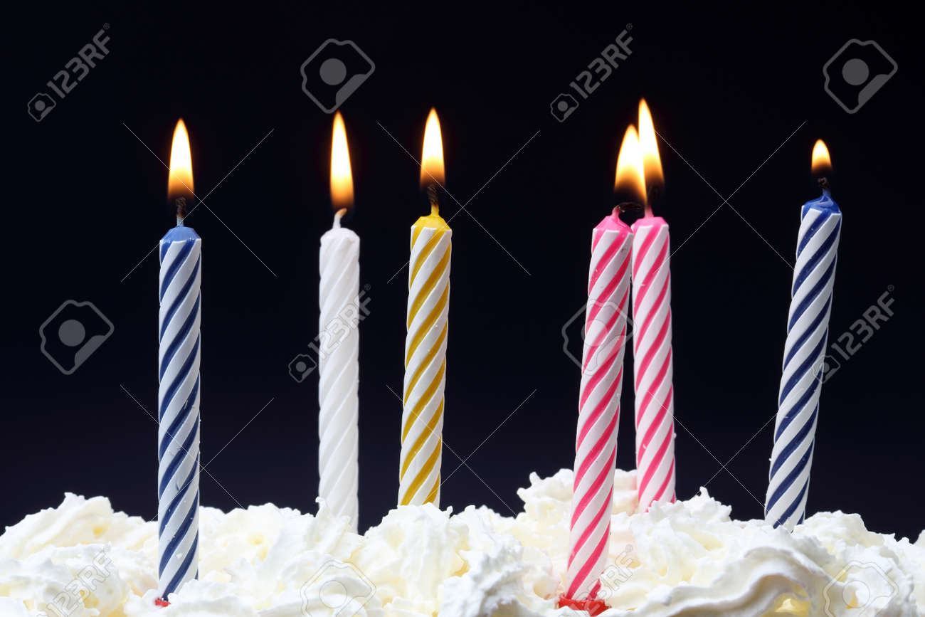 some lit birthday candles close up stock photo picture and royalty