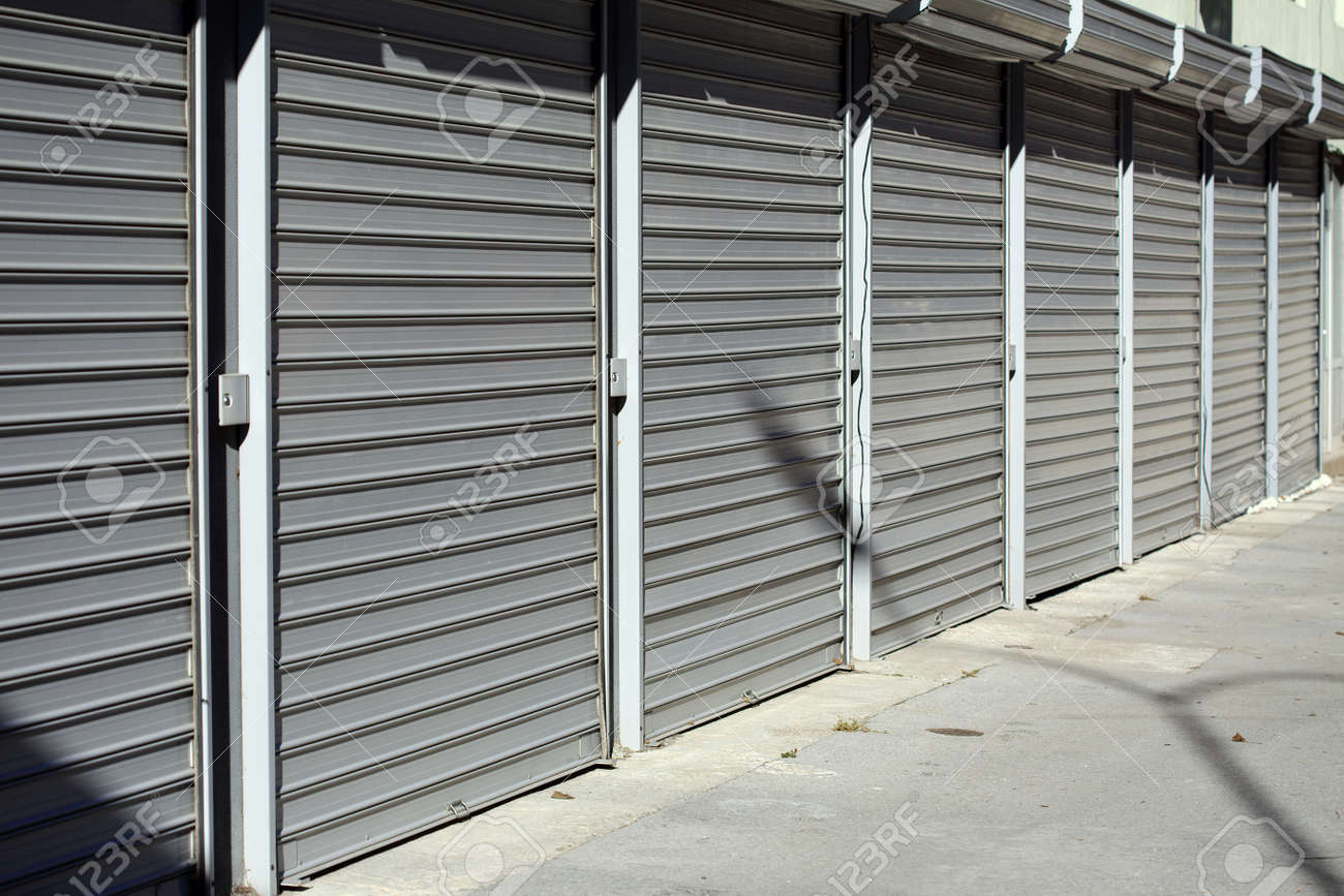 corrugated metal doors of garages Stock Photo - 25107930 & Corrugated Metal Doors Of Garages Stock Photo Picture And Royalty ...