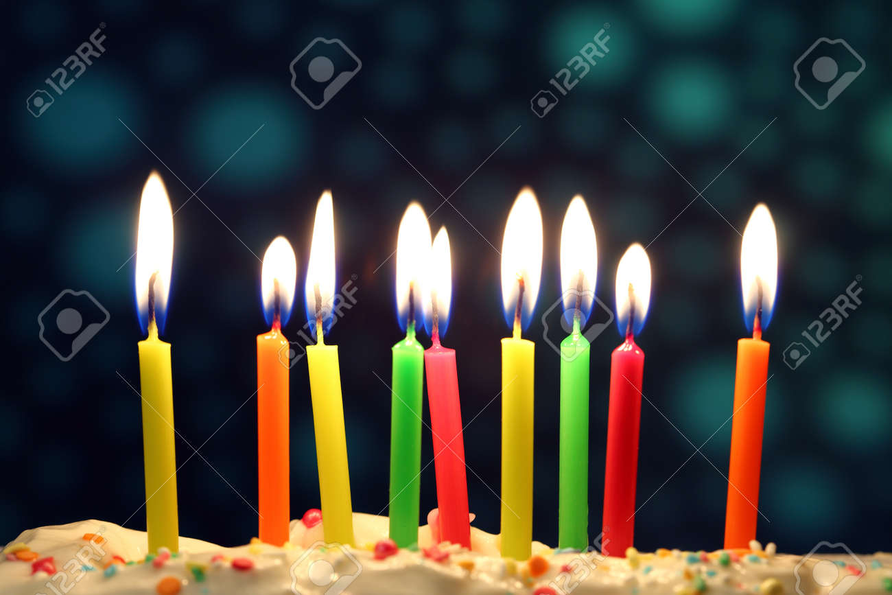 nine lit birthday candles close up shallow dof stock photo picture