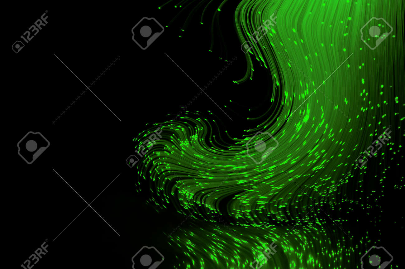 Bright green fiber optic light strands swirling against a black background and reflecting into the foreground. Stock Photo - 8719449