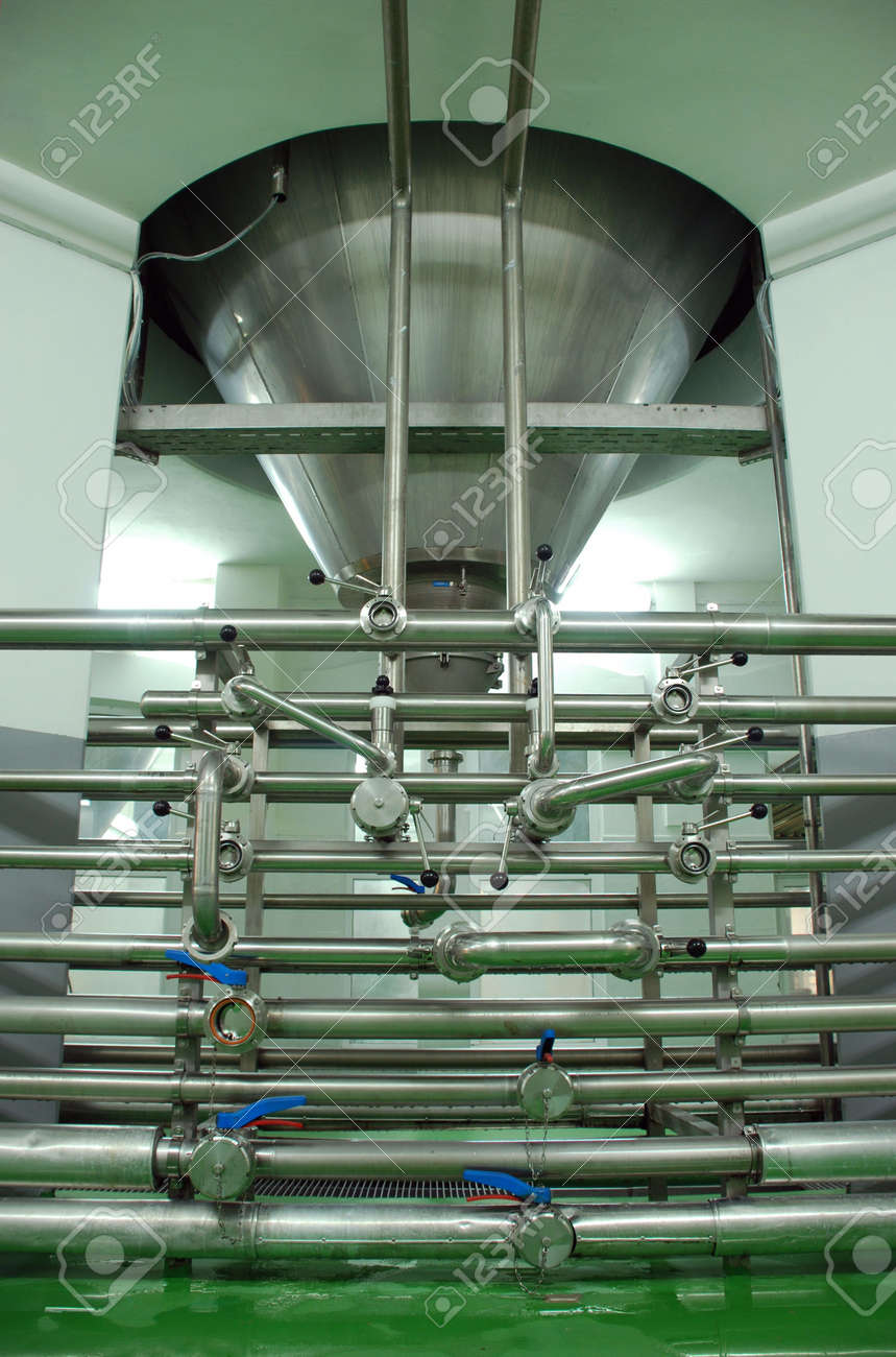 Pipes and fermenting tank in modern Breery Stock Photo - 3771831