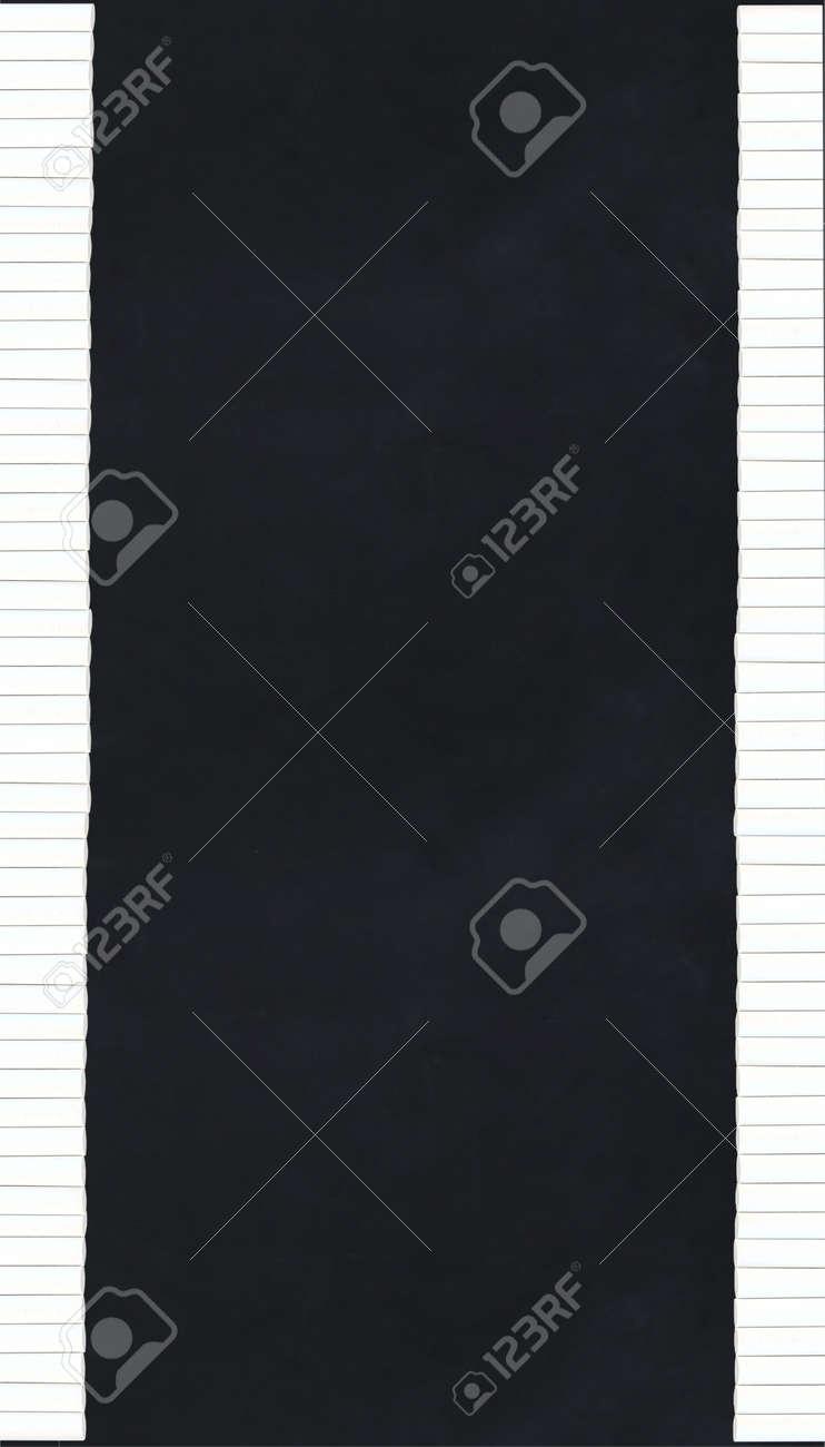 chalk sticks making a border along a black chalkboard - vertical Stock Photo - 14268709