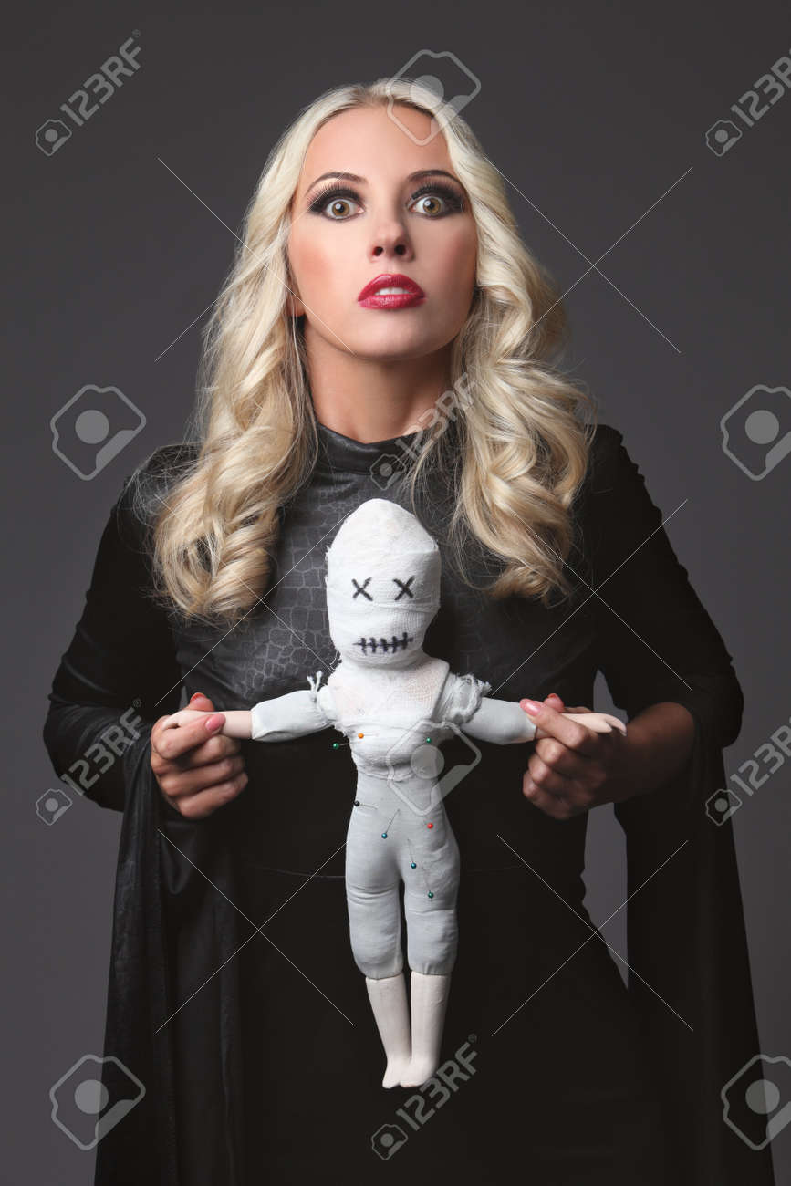 witch holding a voodoo doll costume for halloween party blond