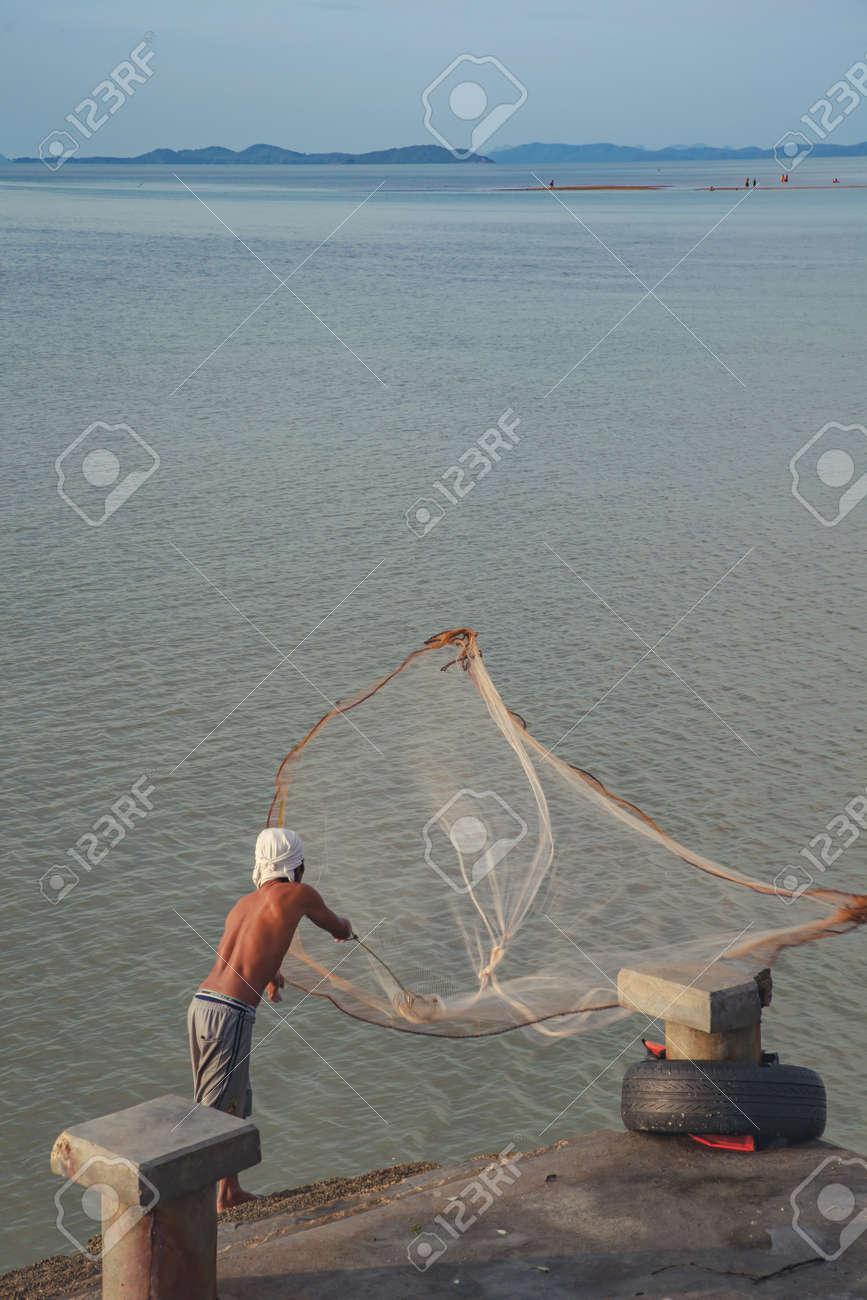 Phuket Thailand July 17 Fishermen Casting Fishing Sea Laem Stock Photo Picture And Royalty Free Image Image 42364752