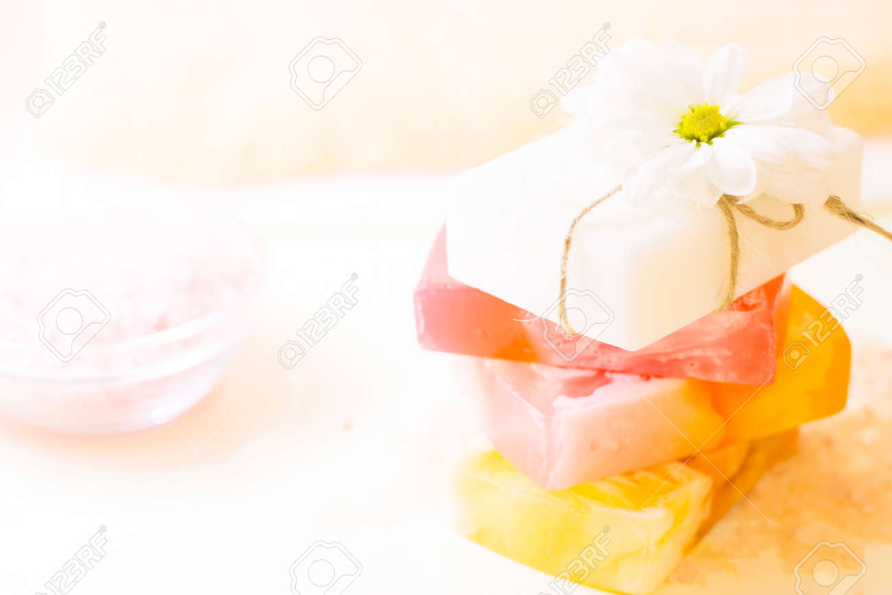 Enjoy fruit and flower fragrances in the bath. A pile of bars of homemade moisturizing