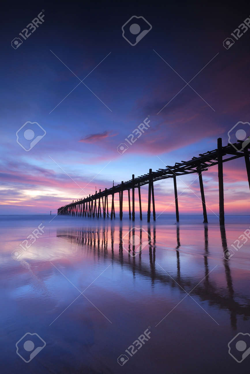 Filed wooden bridge into the sea after sunset on the beach Stock Photo - 14658073