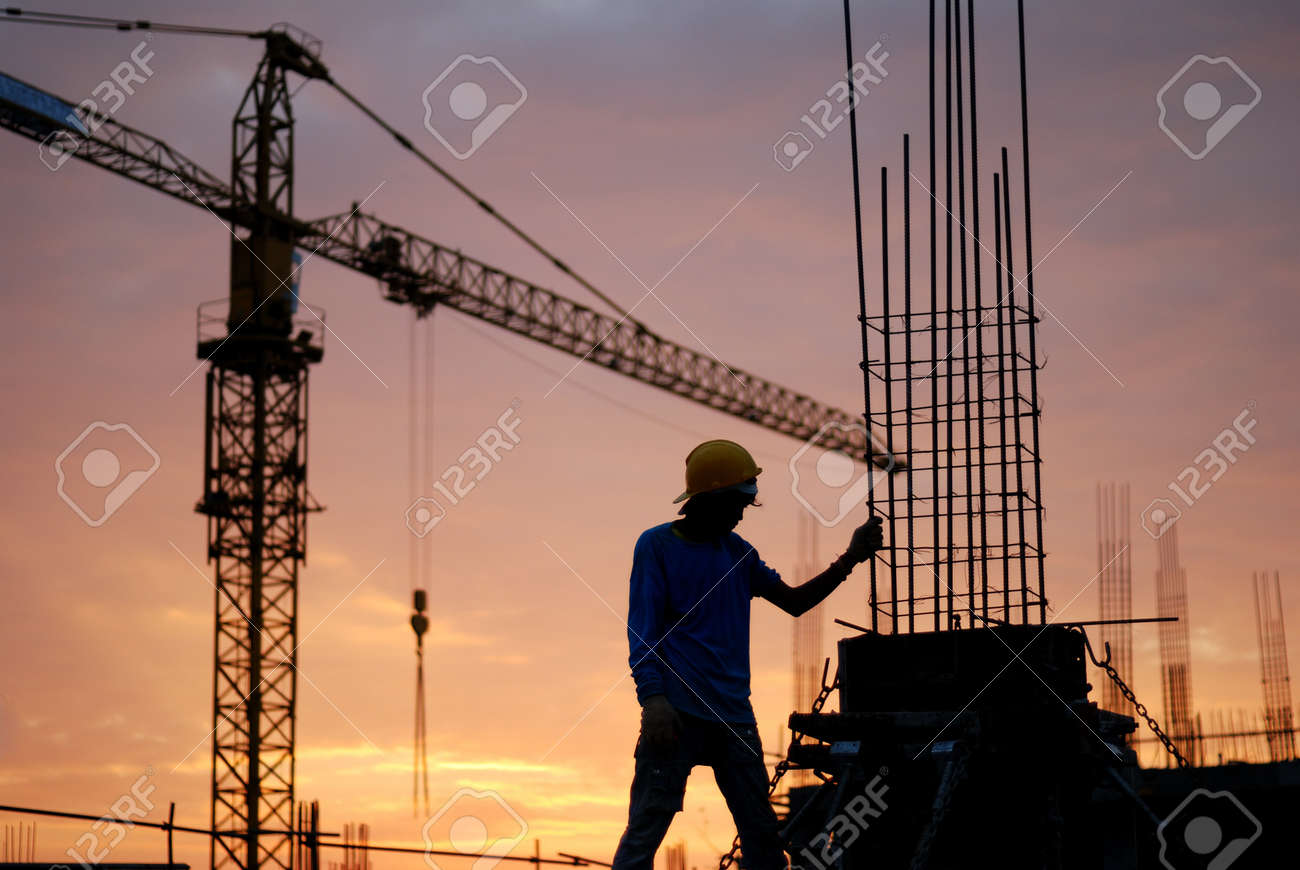 Black silhouette of the building construction is not finished. Stock Photo - 15182521