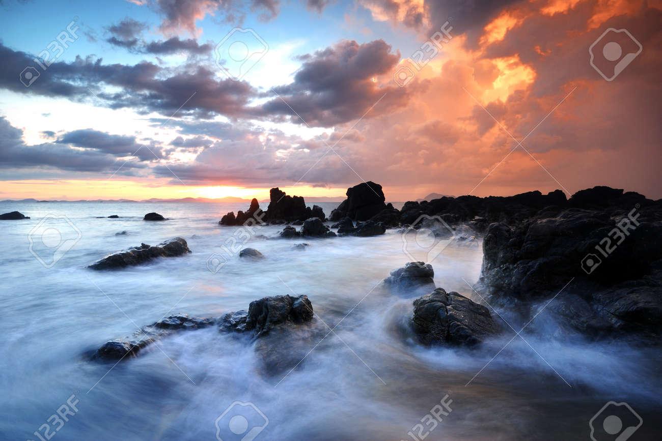 Sea waves lash line impact rock onthe beach Stock Photo - 15182525
